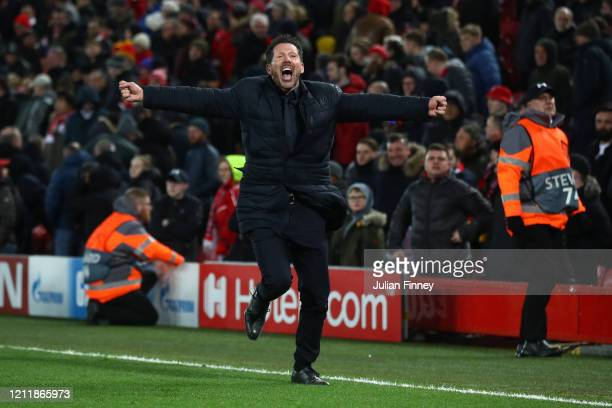 Diego Simeone Manager of Atletico Madrid celebrates his sides third goal during the UEFA Champions League round of 16 second leg match between...
