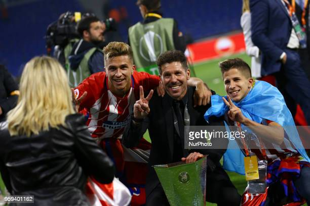 Diego Simeone manager of Atletico with the sons Giuliano and Gianluca posing with the trophy at Groupama Stadium in Lyon, France on May 16, 2018...