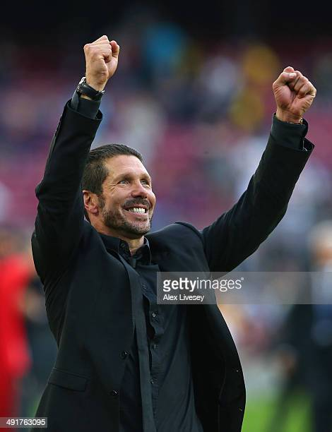 Diego Simeone the coach of Club Atletico de Madrid celebrates towards his supporters after winning the La Liga after the match between FC Barcelona...