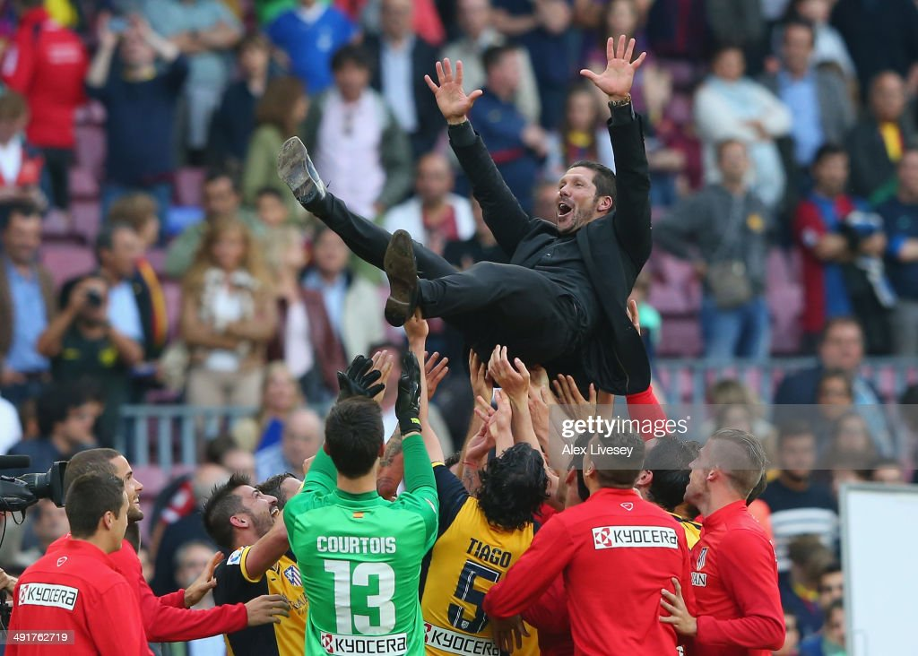 Diego Simeone the coach of Club Atletico de Madrid is thrown in the air by his players after winning the La Liga after the match between FC Barcelona and Club Atletico de Madrid at Camp Nou on May 17, 2014 in Barcelona, Spain.