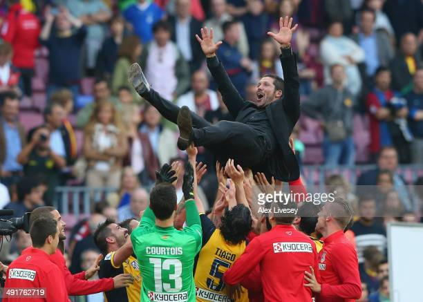 Diego Simeone the coach of Club Atletico de Madrid is thrown in the air by his players after winning the La Liga after the match between FC Barcelona...