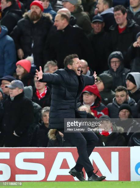 Diego Simeone the manager of Atletico Madrid celebrates towards his supporters after their second goal is scored during UEFA Champions League round...
