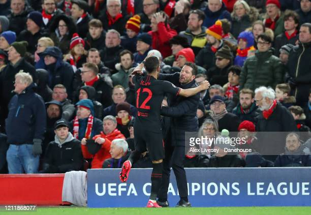 Diego Simeone the manager of Atletico Madrid celebrates with Renan Lodi after their second goal is scored during UEFA Champions League round of 16...