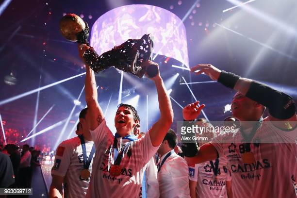 Diego Simonet and team mates of Montpellier present the trophy to the fans after winning the EHF Champions League Final 4 Final match between Nantes...