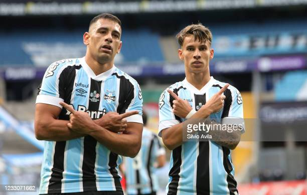 Diego Souza and Ferreira of Gremio celebrate after scoring the first goal of his team during the final of Rio Grande Do Sul State Championship 2021...
