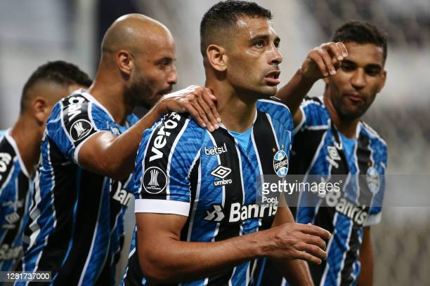 Diego Souza of Gremio celebrates after making a penalty to score the tying goal during a Group E match of Copa CONMEBOL Libertadores 2020 between...