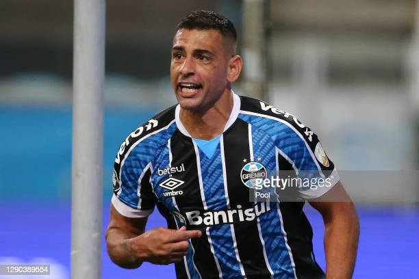Diego Souza of Gremio celebrates after scoring the first goal of his team during a first leg match between Gremio and Santos as part of Copa CONMEBOL...