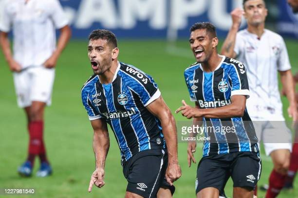 Diego Souza of Gremio celebrates with his teammate Isaque of Gremio after scoring the first goal of his team during the match between Gremio and...