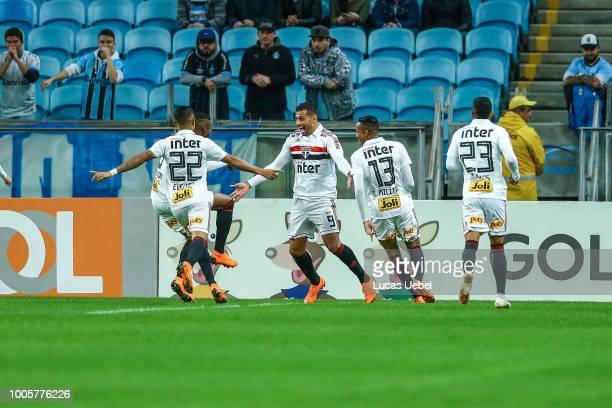 Diego Souza of Sao Paulo celebrates their first goal during the match Gremio v Sao Paulo as part of Brasileirao Series A 2018 at Arena do Gremio on...