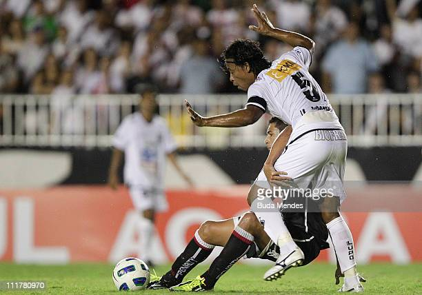 Diego Souza of Vasco struggles for the ball with Sidiney of ABC during a match as part of Brazil Cup 2011 at Sao Januario stadium on April 06, 2011...