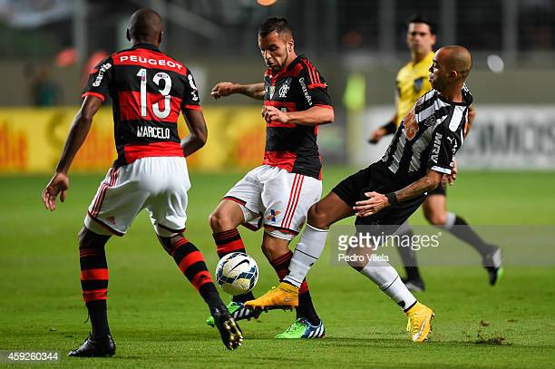 Diego Tardelli of Atletico MG and Canteros of Flamengo battle for the ball during a match between Atletico MG and Flamengo as part of Brasileirao...