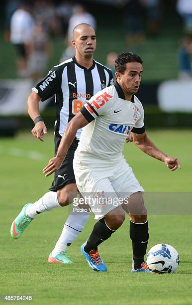 Diego Tardelli of Atletico MG and Jadson of Corinthians battle for the ball during a match between Atletico MG and Corinthians as part of Brasileirao...