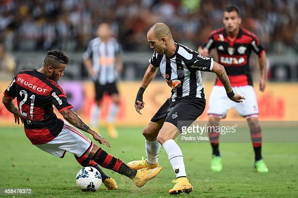 Diego Tardelli of Atletico MG and Leo of Flamengo battle for the ball during a match between Atletico MG and Flamengo as part of Copa do Brasil 2014...