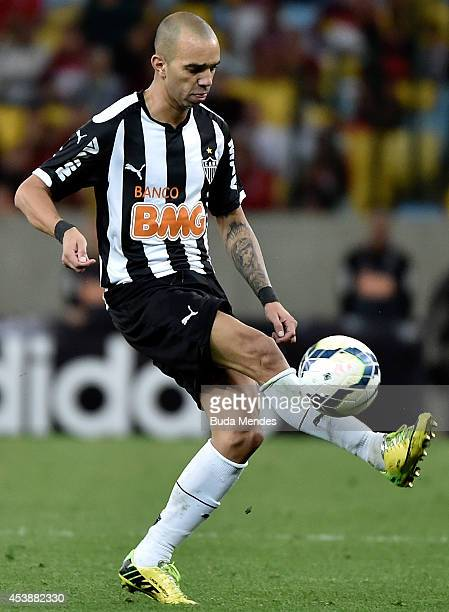Diego Tardelli of Atletico MG struggles for the ball during a match between Flamengo and Atletico MG as part of Brasileirao Series A 2014 at Maracana...