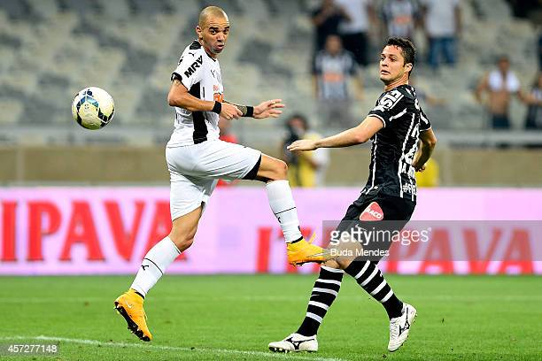 Diego Tardelli of Atletico MG struggles for the ball with Anderson Martins of Corinthians during a match between Atletico MG and Corinthians as part...