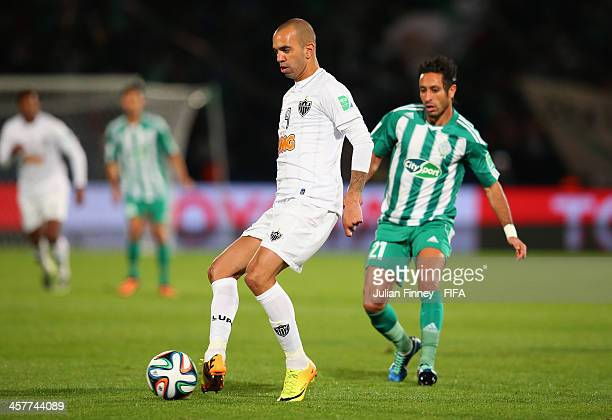 Diego Tardelli of Atletico Mineiro passes the ball ahead of Adil Karrouchy of Raja Casablanca during the FIFA Club World Cup Semi Final match between...