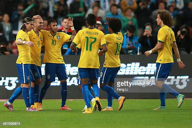 Diego Tardelli of Brazil celebrates after scoring the first goal during Super Clasico de las Americas between Argentina and Brazil at Beijing...
