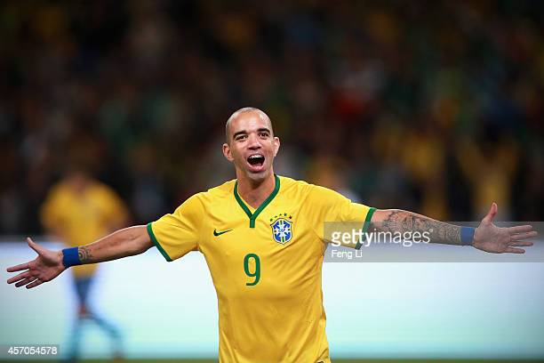 Diego Tardelli of Brazil celebrates after scoring the second goal during Super Clasico de las Americas between Argentina and Brazil at Beijing...