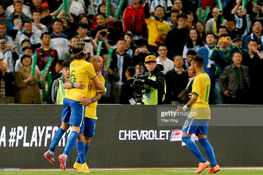 Diego Tardelli #9 of Brazil celebrates with teammates after scoring his team's first goal during a match between Argentina and Brazil as part of 2014 Superclasico de las Americas at Bird Nest Stadium on October 11, 2014 in Beijing, China.