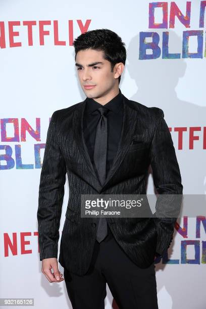 Diego Tinoco attends the premiere of Netflix's On My Block at NETFLIX on March 14 2018 in Los Angeles California