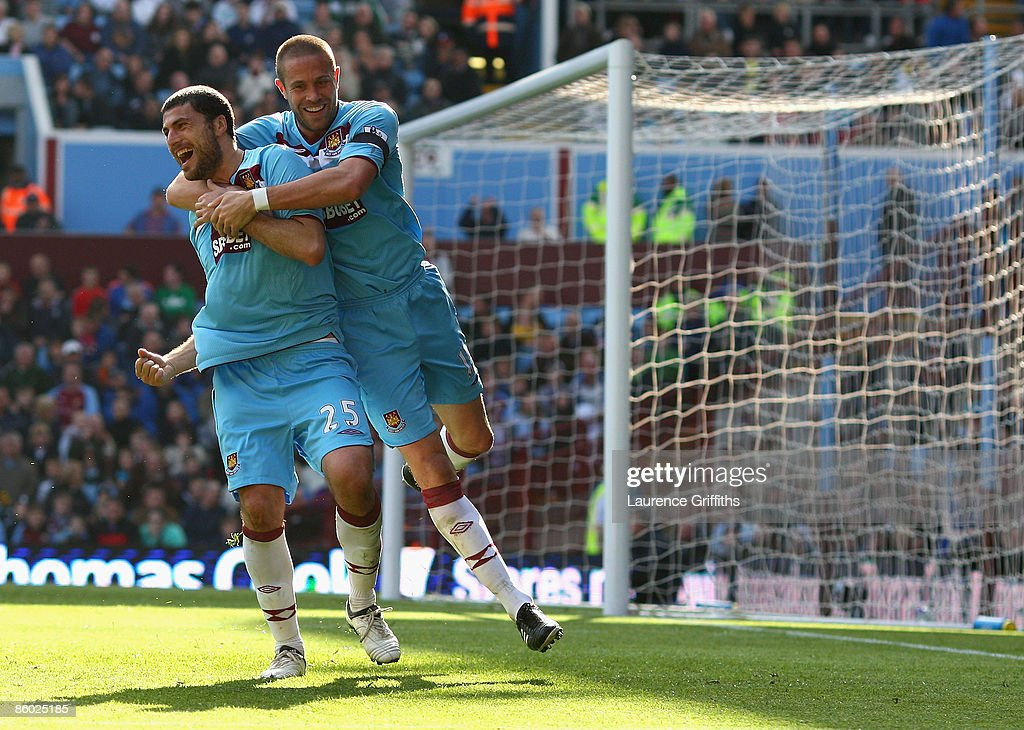 Diego Tristan of West Ham is congratulated on scoring the equaliser by Matthew Upson during the Barclays Premier League match between Aston Villa and West Ham United at Villa Park on April 18, 2009 in Birmingham, England