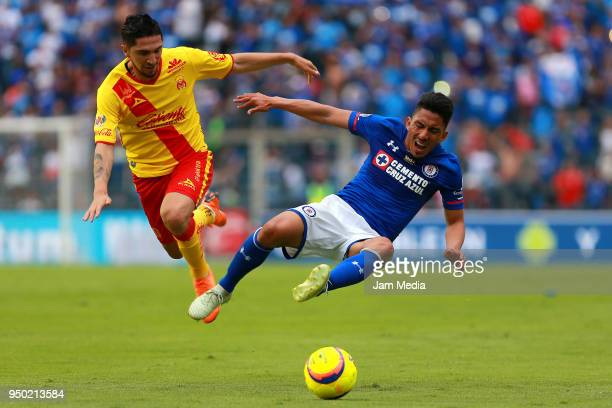 Diego Valdes of Morelia and Angel Mena of Cruz Azul fight for the ball during the 16th round match between Cruz Azul and Morelia at Azul Stadium on...