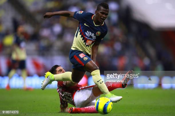 Diego Valdes of Morelia struggles for the ball with Darwin Quintero of America during the 7th round match between America and Monarcas as part of the...