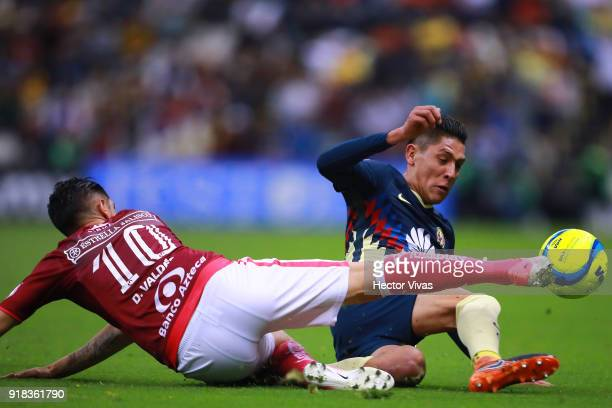 Diego Valdes of Morelia struggles for the ball with Edson Alvarez of America during the 7th round match between America and Monarcas as part of the...