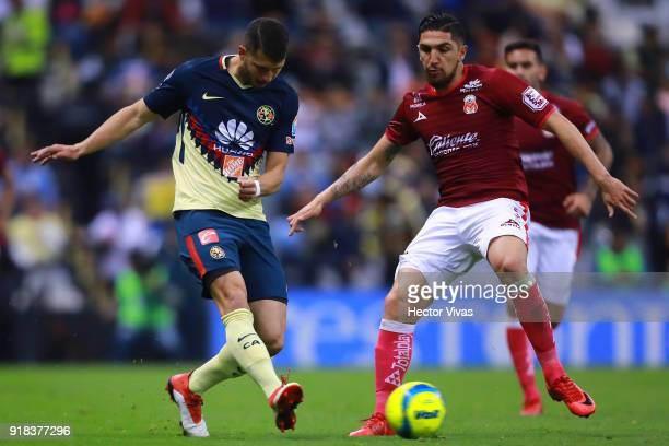 Diego Valdes of Morelia struggles for the ball with Guido Rodriguez of America during the 7th round match between America and Monarcas as part of the...