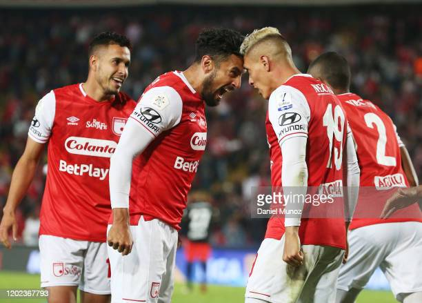 Diego Valdez of Santa Fe celebrates with teammate Andres Perez after scoring during a match between Independiente Santa Fe and America de Cali as...