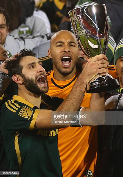 Diego Valeri and Adam Kwarasey of Portland Timbers celebrate with the MLS Western Conference trophy after defeating FC Dallas in the Western...