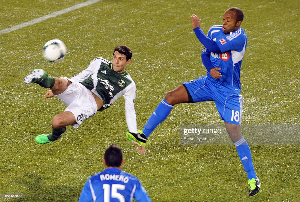 Diego Valeri #8 of Portland Timbers puts a shot on goal as Collen Warner #18 of Montreal Impact defends during the second half of the game at Jeld-Wen Field on March 09, 2013 in Portland, Oregon. Montreal won the game 2-1.