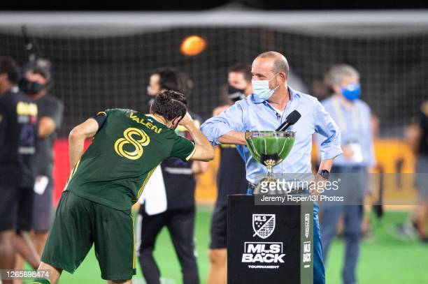 Diego Valeri of the Portland Timbers celebrate with Don Garber after a game between Orlando City SC and Portland Timbers at ESPN Wide World of Sports...