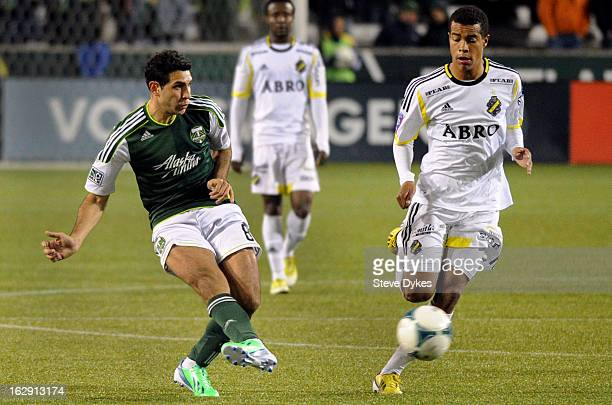 Diego Valeri of the Portland Timbers passes the ball as Robin Quaison of AIK closes in during the second half of the game at JeldWen Field on...