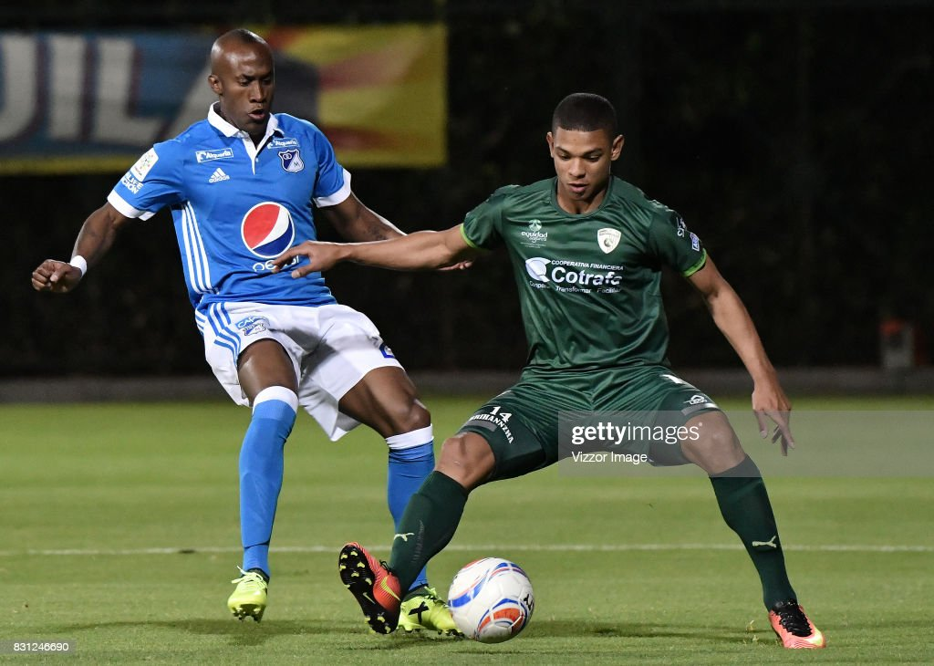 Diego Valoyes of Millonarios and Felipe Banguero of La Equidad fight for the ball during a match between La Equidad and Millonarios as part of round 7 of Liga Aguila II at Estadio Metropolitano de Techo on August 12, 2017 in Bogota, Colombia.