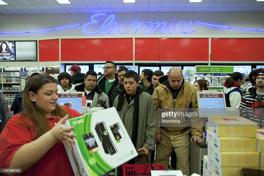 Black Friday Shoppers Chase Deals At Wal-Mart, Best Buy : News Photo