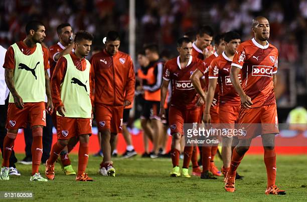 Diego Vera of Independiente and his teammates leave the field after losing a match between River Plate and Independiente as part of fifth round of...