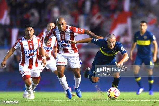 Diego Zabala of Union fights for the ball with Nicolas Capaldo of Boca Juniors during a friendly match between Boca Juniors and UniÛn de Santa Fe at...