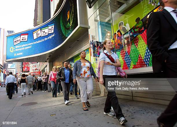 Diehard Elmo fans file into Toys 'R' Us in Times Square in the hopes of buying an Elmo TMX doll TMX which stands for 'TickleMeElmo Ten' or...