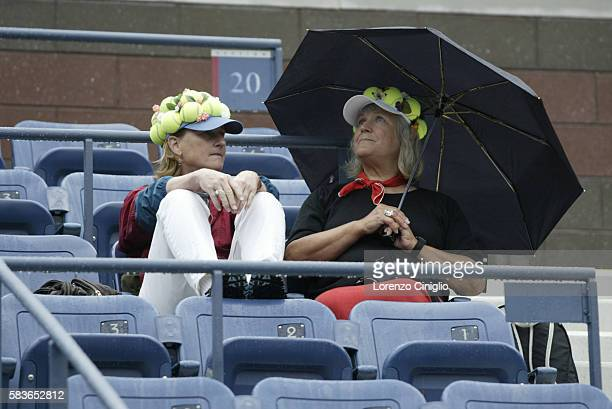 Die-hard tennis fans decided to wait out a rain delay at Arthur Ashe Stadium during Day 10 of the US Open Tennis Tournament.