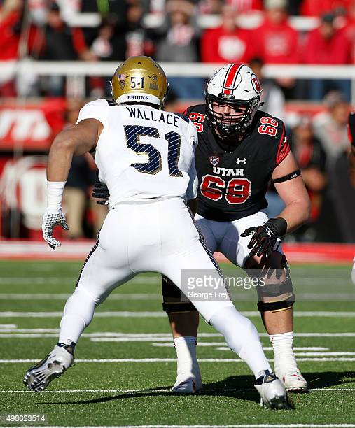 J Dielman of the Utah Utes prepare to block Aaron Wallace of the UCLA Bruins during the first half of a college football game at Rice Eccles Stadium...