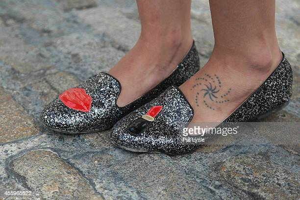 Dienna from Portugal wears flat shoes by Chiara Ferragni on day 2 of London Fashion Week SS 2015 on September 13 2014 in London England