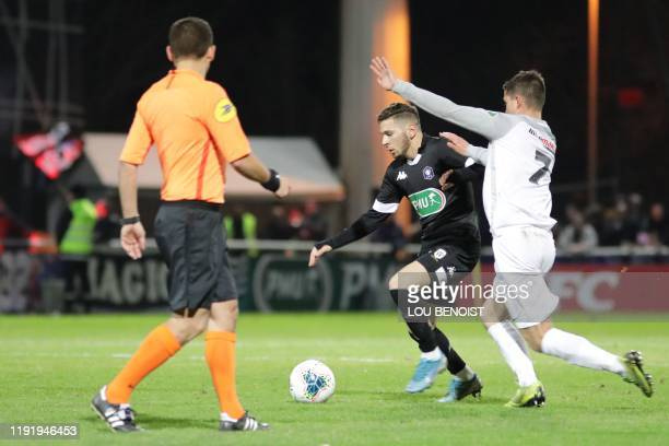 Dieppe's Remy Chombart vies with Angers's Farid El Melali during the French Cup League football match between Dieppe and Angers at Des Vertus stadium...