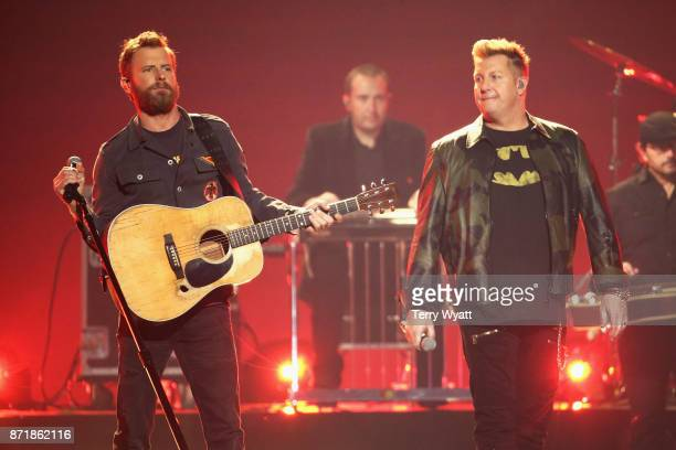 Dierks Bentley and Gary LeVox perform onstage during the 51st annual CMA Awards at the Bridgestone Arena on November 8 2017 in Nashville Tennessee