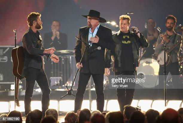 Dierks Bentley Eddie Montgomery and Gary LeVox perform onstage during the 51st annual CMA Awards at the Bridgestone Arena on November 8 2017 in...