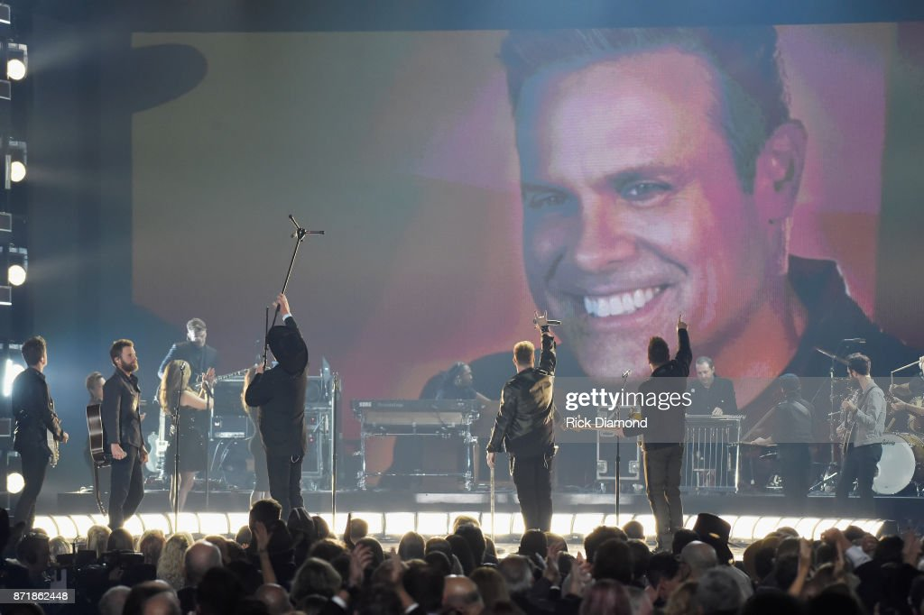 Dierks Bentley, Eddie Montgomery, Gary LeVox, and Jay DeMarcus perform onstage at the 51st annual CMA Awards at the Bridgestone Arena on November 8, 2017 in Nashville, Tennessee.