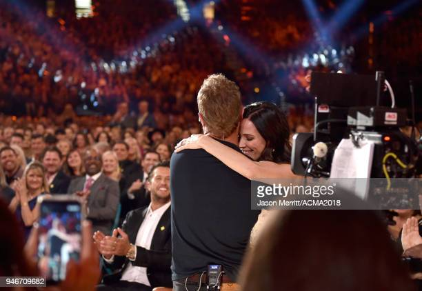 Dierks Bentley embraces Cassidy Black during the 53rd Academy of Country Music Awards at MGM Grand Garden Arena on April 15 2018 in Las Vegas Nevada