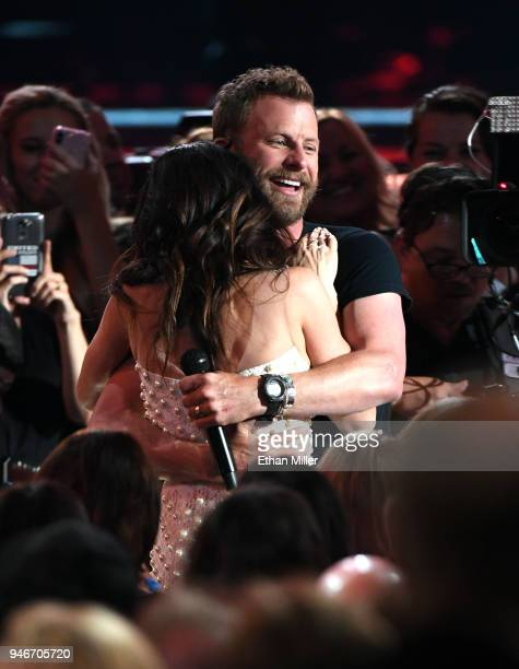 Dierks Bentley hugs his wife Cassidy Black as he performs during the 53rd Academy of Country Music Awards at MGM Grand Garden Arena on April 15 2018...