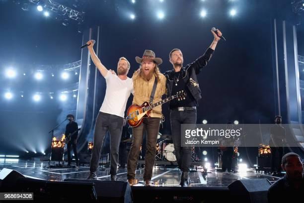 Dierks Bentley John Osborne and TJ Osborne perform onstage at the 2018 CMT Music Awards at Bridgestone Arena on June 6 2018 in Nashville Tennessee
