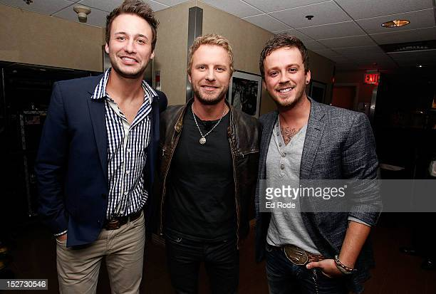 Dierks Bentley poses with Eric Gunderson and Stephen Barker of Love Theft backstage at the 6th Annual ACM Honors at Ryman Auditorium on September 24...